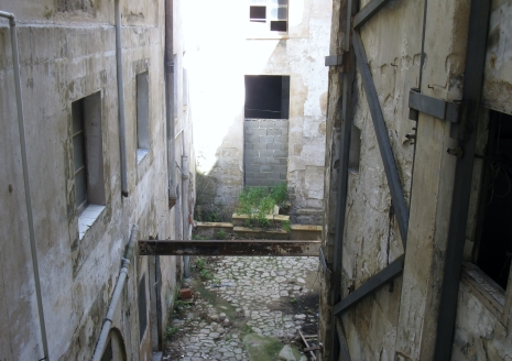 View from our room. Some parts of Palma were very run-down. I could find no way into this area. Our hotel must have looked like this and had been beautifully re-furbished. Hopefully re-development in the future.